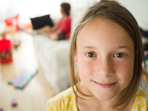 Little girl in a messy living room Stock Photos