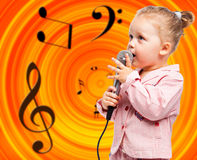 Little girl with microphone Royalty Free Stock Images