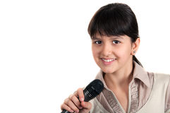 Little girl with a microphone Stock Images
