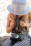 Little girl with microscope Stock Photo