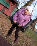 Little girl mid swing Stock Photo