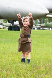 Little girl in a military uniform Stock Photo