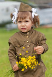 Little girl in a military uniform Stock Photos