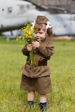 Little girl in a military uniform Royalty Free Stock Photos