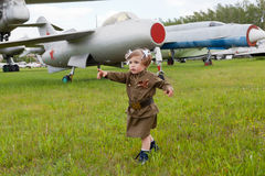 Little girl in a military uniform Stock Image