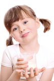 Little girl with milk Royalty Free Stock Photography