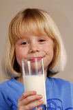 Little girl with milk. Royalty Free Stock Photography