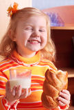Little girl with milk Stock Image