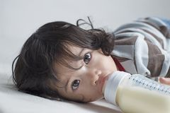 Little Girl With Milk Stock Images