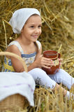 Little girl with milk in field Stock Image