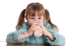 The little girl with a milk glass Stock Photo