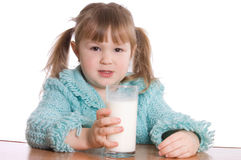 The little girl with a milk glass Royalty Free Stock Photos
