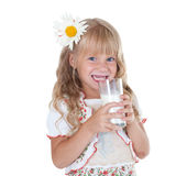 Little girl with milk mustache. After drinking milk isolated on white background stock image