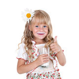 Little girl with milk mustache. After drinking milk showing thumb up isolated on white background stock images