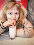 Little girl with milk shake Royalty Free Stock Images