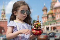 Little girl with a miniature cathedral. Little girl in sunglasses with a miniature cathedral royalty free stock photo