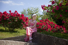Little girl in Mirabell gardens. In Salzburg city , Austria royalty free stock photo