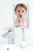 Little girl in a mirror Royalty Free Stock Photos