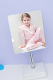 Little girl in a mirror Royalty Free Stock Image