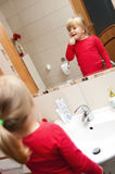 Little girl and mirror Royalty Free Stock Photos