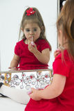 Little girl in Mirror Royalty Free Stock Images