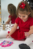 Little girl in Mirror Stock Photography