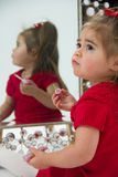 Little girl in Mirror Stock Images
