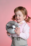 Little girl with mirror sphere Royalty Free Stock Images