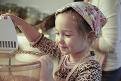 Little girl mixing dough for a birthday cake Stock Image