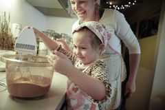 Little girl mixing dough for a birthday cake Royalty Free Stock Photos