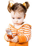 Little girl with mobile phon. Little girl is playing in java game on mobile phone Royalty Free Stock Photos