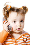 Little girl with mobile phone. Little girl is calling on mobile phone Stock Photography