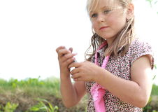 Little girl with a mobile phone. Little girl in a flowered dress holding a mobile phone Stock Photography