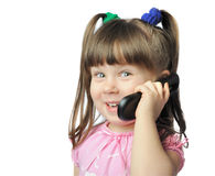 Little girl with a mobile phone Royalty Free Stock Photo