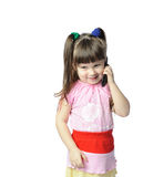 Little girl with a mobile phone Stock Images
