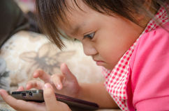 Little girl with mobile phone Royalty Free Stock Images