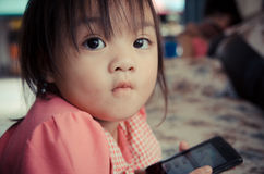 Little girl with mobile phone Royalty Free Stock Photos
