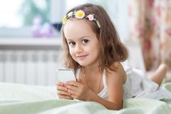 Little girl with mobile phone in her hands Stock Image