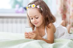 Little girl with mobile phone in her hands Royalty Free Stock Photo