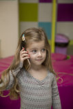 Little girl with mobile phone Stock Images