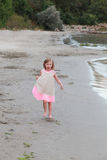 Little girl (model) running in sand Stock Image