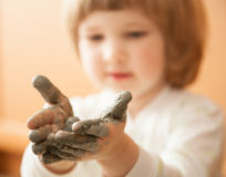 Little girl modelling clay toy Royalty Free Stock Photo