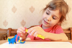 Little girl models from plasticine Royalty Free Stock Image