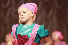 Little girl in modern dance on the stage. Of dancing performance stock photo