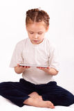Little girl with modern tablet device Stock Image