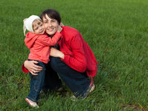 Little girl with mom Royalty Free Stock Image