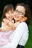 Little girl with mom Stock Images
