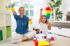 Little girl and mom cleaning room Stock Photo