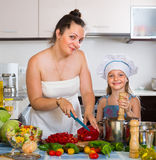 Little girl with mom at kitchen Royalty Free Stock Photography