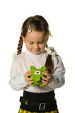 The little girl with a money box - a pig Stock Photos